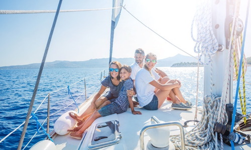 family with kids resting on yacht adventure travel