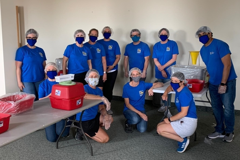 RBC employees pack food Harvestpack